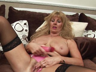wicked blonde lady playing with a dildo