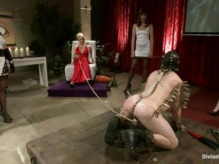 divine bitches humiliate their slave on stage before an audience