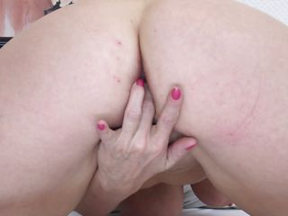 mature fingering her shaved vagina and groaning with pleasure