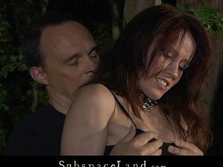 Redhead slut restrained and fucked in the woods
