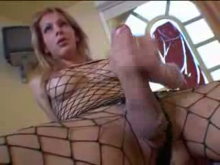 Blonde lady-boy in fishnet has a big dick