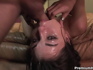 Well known dark-haired haired porn diva Sasha Grey receives her mouth fucked extremely deep. This babe receives a mouthful of sex cream after coarse face fucking on the couch.