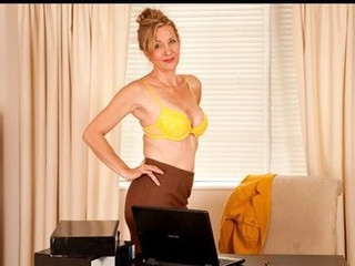 Attractive business woman takes a break to masturbate