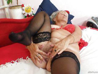 granny golden-haired slut fingering her vagina