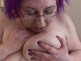breasty granny nataline playing with her body