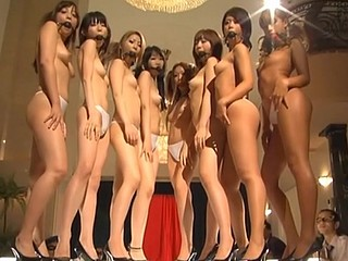 Oriental whores with mouthes filled posing totally naked