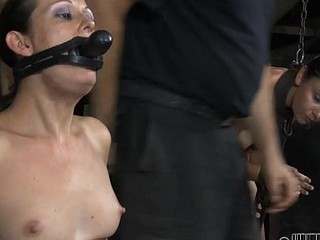This poor woman getting her mouth stuffed with the weird toy
