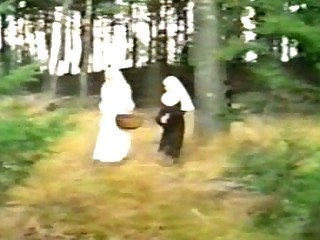 Dirty nuns sharing weenie outdoor