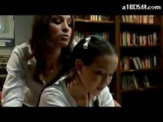 Schoolgirl In Skirt Getting Spanked By Other Angel In The Library
