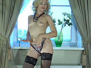Ninette teasing with her stockings