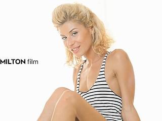 Kinky blonde uses her pretty feet to stroke a rod