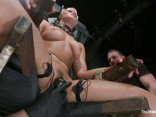 blond in bondage device receives harsh treatment