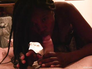 ebony slut sucking a hard white dick