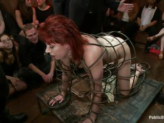 redhead milf in a cage humiliated and drilled