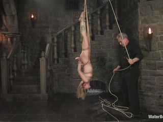 pretty blond milf hanging upside down and getting wet