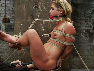 tied up blonde taking her torment