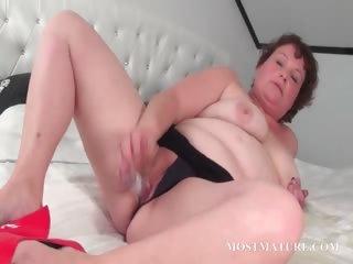 Mature slut pleasuring her pussy in ottoman