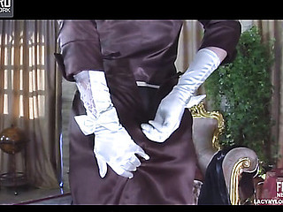 Glam playgirl putting on vintage six-strap nylons with a fancy hat and gloves