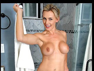 Stunning blond cougar Tanya Tate masturbates in the shower