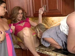 Kristen  Bree and Lakota muff licking on the kitchen counter.