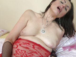 horny matyre lady playing fake penis