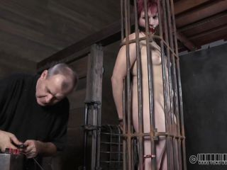 throat gagged in a small cage
