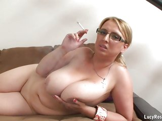 Hot cougar Lucy Rose posing and smokin'