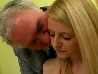 Mature old guy is fingering the small vagina hole of blonde babe