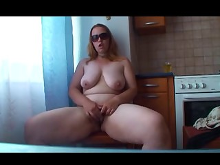 Non-professional chubby redhead plays on cam