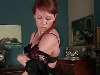 Redhead mom new to porno seductively bares down to nothing but stockings to showcase off her fit shape and rub her fuzzy wet pussy