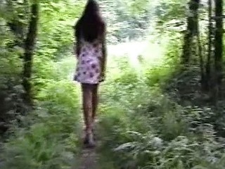 Cute brunette hair goes walking in the woods naked and takes a pee