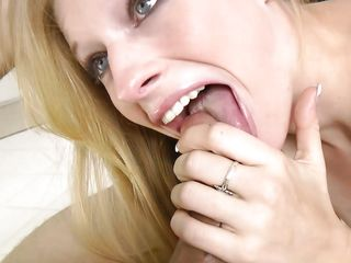 blonde babe gags on a massive cock