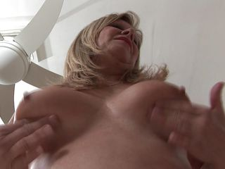european mature takes off her pants