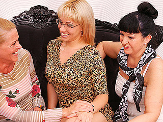 Take a look at these three obscene mature bitches making out on bed