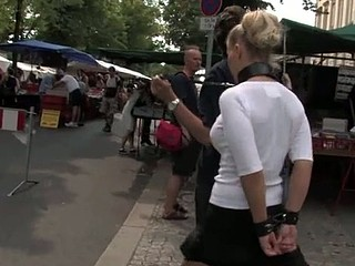Public punishment for blonde bitch in leash