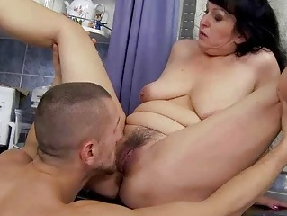 Breasty granny gets fucked in the kitchen