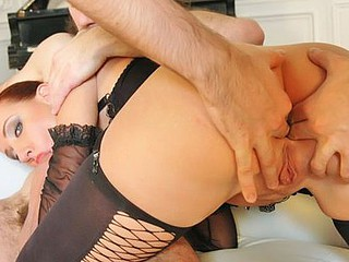 Maggie Red gets fucked by two large knobs.
