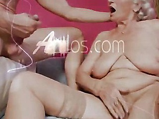 Breasty grandma sucks strapon and gets fucked by a youthful chap