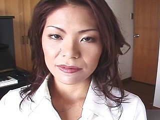 See this Japanese MILF take off her pantyhose and masturbate